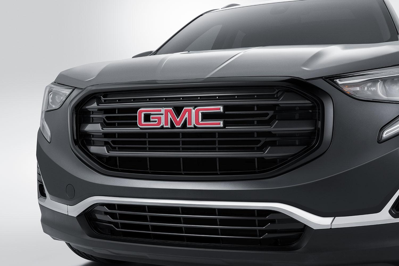 Parrilla negra con logo GMC